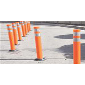 [Image Description: A row of orange cylindrical pole style delineators lined up on a road.]